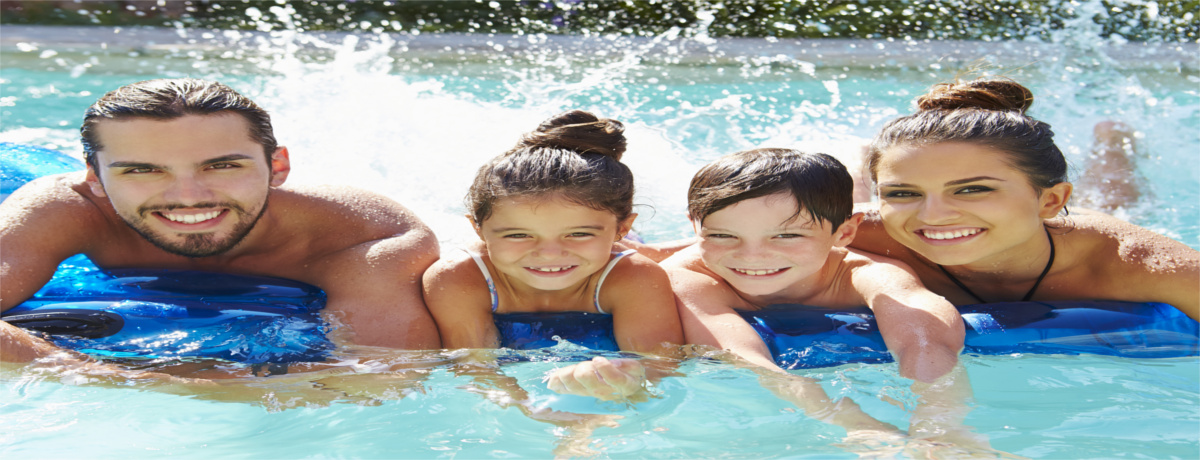 family in solar heated pool