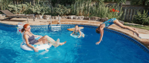 Pure Pool Heating family enjoying heated pool