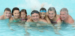 Happy family enjoying heated swimming pool